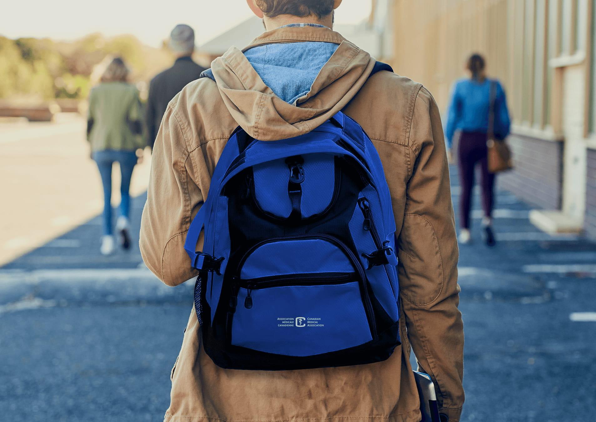 Medical student wearing a Canadian Medical Association backpack