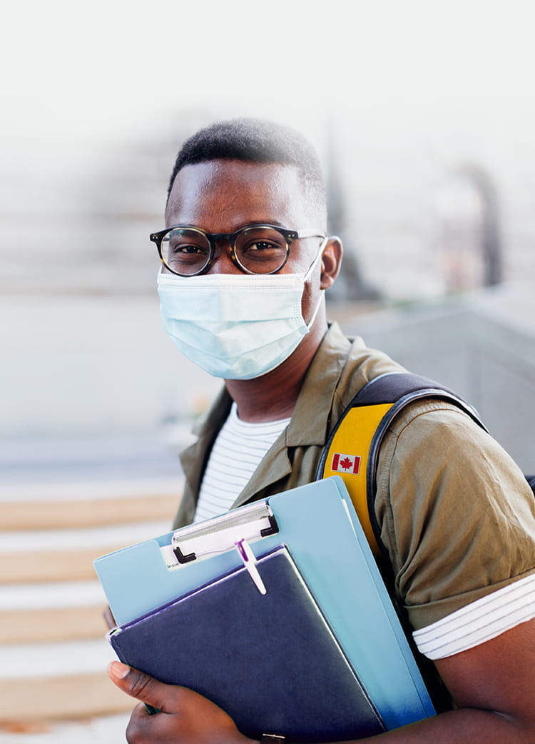 Medical student wearing a mask and a backpack